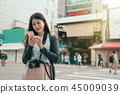 lady tourist using online map app on cellphone 45009039