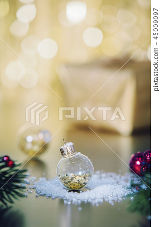 Christmas decoration with balls and snow - close up 45009097