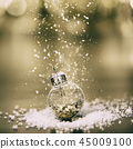 Christmas decoration with balls and snow - close up 45009100