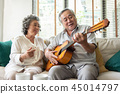Older Couple enjoying with singing and guitar. 45014797