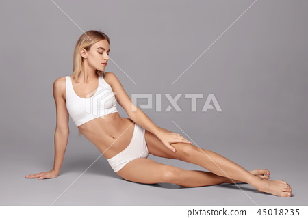 Perfect slim toned young body of the girl . 45018235