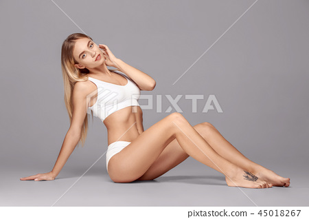 Perfect slim toned young body of the girl . 45018267