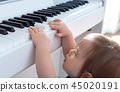 Toddler boy playing the piano 45020191