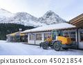 Snow removal machinery in alpine decor 45021854