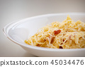 Macaroni carbonara presented on a white dish 45034476