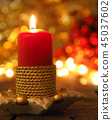 One Advent candle burning 45037602