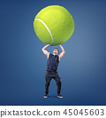 A small young muscular man tries to hold a giant yellow tennis ball above his head. 45045603