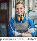 Woman worker in her metal workshop posing with tools 45046624