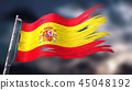 Ripped and torn flag of Spain in bad weather 45048192