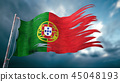 Ripped and torn flag of Portugal in bad weather 45048193