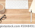Wood office desk table with laptop, notebook, pen. 45048491
