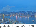 a Skyline of Hong Kong at night with the moon 45052200