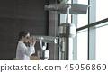Teenage girl looks through Abu Dhabi telescope from observation deck 45056869