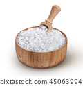 Sea salt in wooden bowl with scoop isolated on white background 45063994