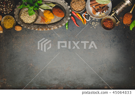 Herbs and spices on dark background - space for text 45064833