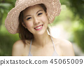 Young asian woman smiling brightly at outdoor. 45065009