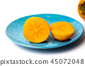 Persimmon kaki fruit on a plate isolated 45072048