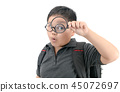 Happy asian fat boy holding magnifying glass. 45072697