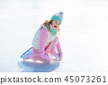 Child skating on natural ice. Kids with skates. 45073261