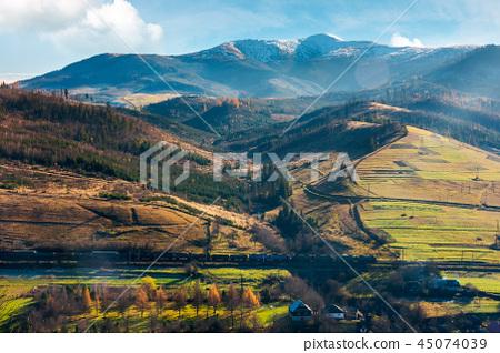 mountain ridge with snowy peak above the village 45074039