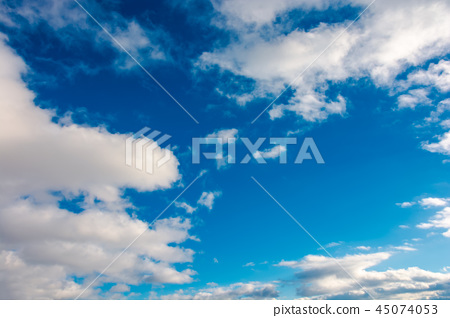 wonderful winter sky with fluffy clouds 45074053