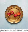 Fresh nectarines fruits on rustic golden plate 45077370