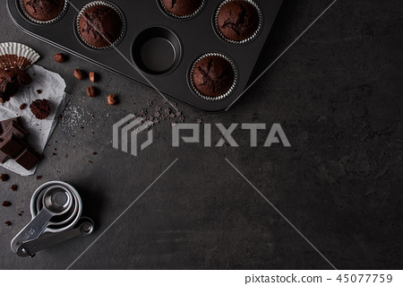 Baking background with chocolate muffins 45077759