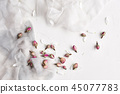 White feminine background with silk and dried rose 45077783