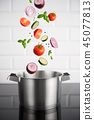 Stainless steel pot with vegetables 45077813