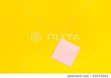 Pastel pink envelope on yellow background 45078883