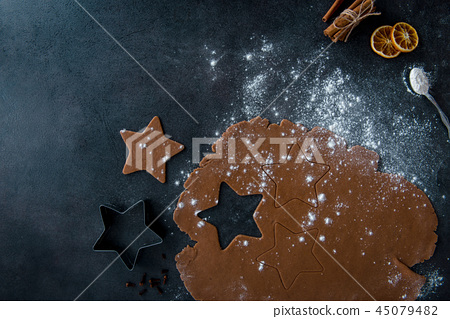 Gingerbread dough with flour and rolling pin 45079482