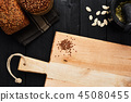 Chopping board and various whole wheat bread 45080455