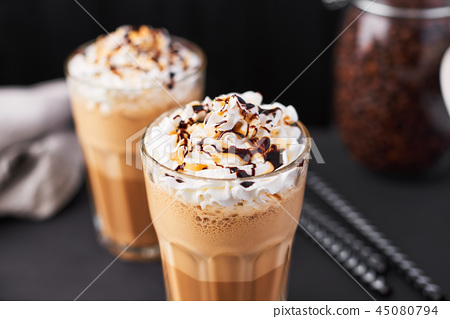 Iced caramel latte coffee in a tall glass 45080794