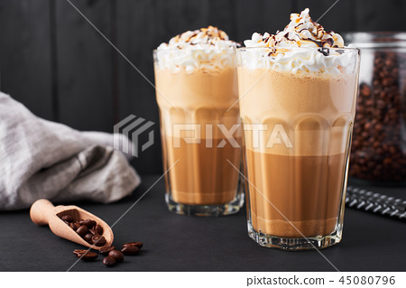 Iced caramel latte coffee in a tall glass 45080796