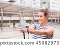 Happy and smiling woman traveler is her selfie 45082973