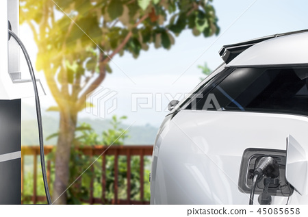 Connect charging station and charger to charge eco-friendly electric car 45085658