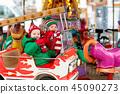 Kids at Christmas fair. Child at Xmas market. 45090273