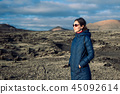 Traveler woman enjoy unique volcanic landscapes of Lanzarote 45092614