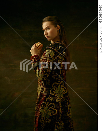 Girl standing in Russian traditional costume. 45096940