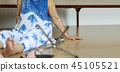 Elderly woman falling down at home,hearth attack. 45105521