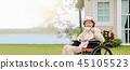 elderly woman relax in backyard 45105523