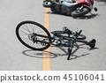 Accident motorcycle crash with bicycle on road 45106041