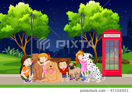 Group of children and dogs in park 45108881