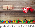 Christmas lights, gift boxes and mittens 45111456
