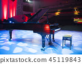 the piano on stage in the spotlight. 45119843