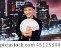 Magician showing trick with playing cards. Magic, circus 45125344