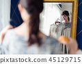 Choosing clothes women mirror 45129715