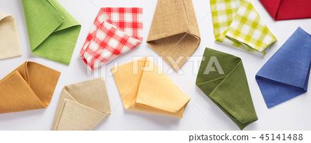 folded table cloth napkin at white background 45141488