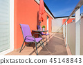 Sunny balcony exterior with chairs 45148843