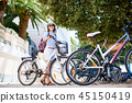 Young woman riding city bicycle near sea 45150419